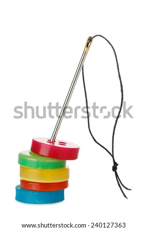 needle with thread and colorful buttons isolated - stock photo