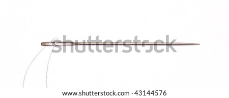 Needle with thread on white background - stock photo