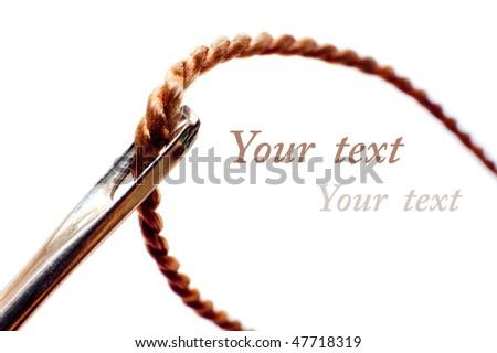 Needle with thread on white background (macro) - stock photo
