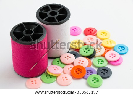 needle with thread/ Spool of thread and buttons, sew instrument isolated on white background - stock photo