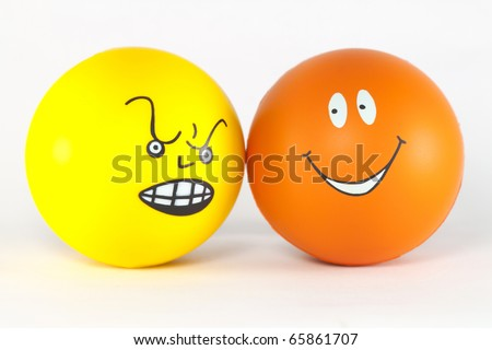 Negative and positive emotions - two balls. - stock photo