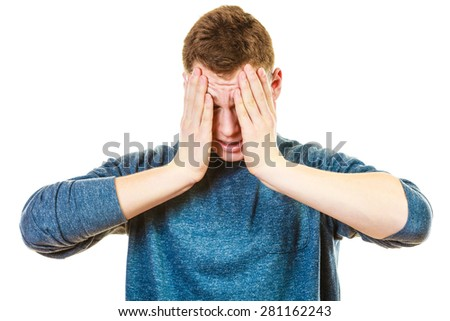 Negative human emotions, facial expressions, reaction attitude. Closeup stressed man holding head with hands isolated - stock photo