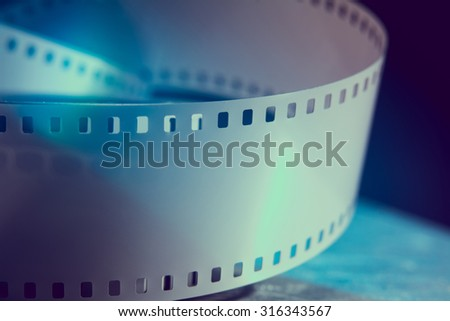 Negative 35 mm film. Photographic film. Background for advertising a new movie - stock photo