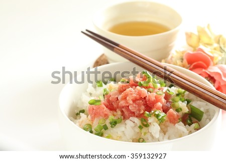 Negitoro don Raw minced tuna on rice with green tea - stock photo