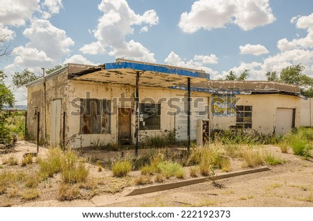 Neglected automotive repair shop and gas station tried selling auto parts before it was abandoned on Route 66 - stock photo
