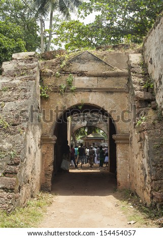 NEGOMBO, SRI LANKA, AUG 12: Visitors waiting at a prison gate inside the former Dutch fort of 1678 in Negombo on august 12, 2013. - stock photo