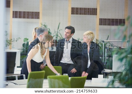 Negotiation of group of business people in an office - stock photo