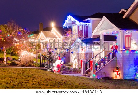 Neighborhood decorated and lighted for Christmas and for New Year Eve at Night in Vancouver, Canada. - stock photo