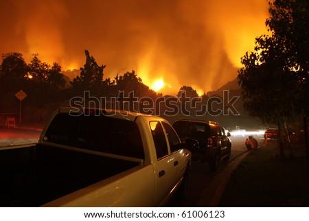 Neighborhood On Fire At Night - stock photo