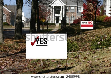 Neighborhood with election signs. These are yes and no that have been cleaned up for your own text. Shows opposition. - stock photo