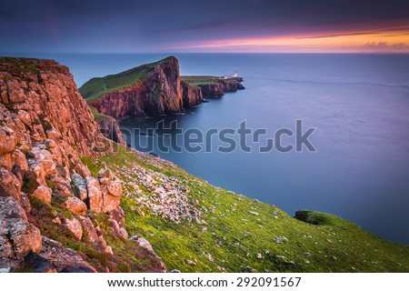 Neist Point, Isle of Skye, Scotland. Neist Point lighthouse during a very cloudy day. - stock photo