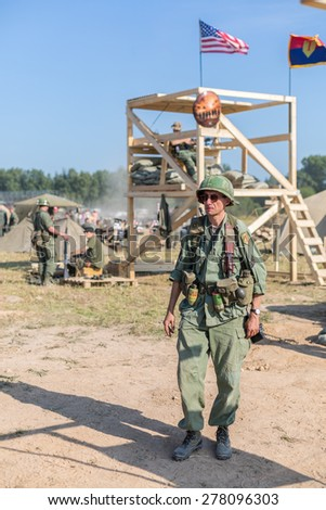 NELIDOVO, RUSSIA- JULY 12, 2014: Battlefield 2014: GI on a background of the observation tower with flags - stock photo