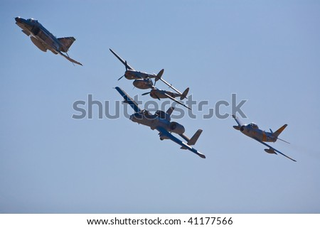 NELLIS AFB, LAS VEGAS, NV - NOVEMBER 14: F-4 Phantom, A-10 Thunderbolt II, P-38 Lightning and F-86F Sabre fly in formation at Aviation Nation 2009 on November 14, 2009 in Nellis AFB, Las Vegas, NV - stock photo