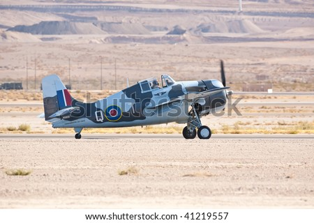 NELLIS AFB, LAS VEGAS, NV - NOVEMBER 14: Grumman F4F Wildcat WWII-era fighter aircraft lands after performing at Aviation Nation 2009 on November 14, 2009 in Nellis AFB, Las Vegas, NV - stock photo