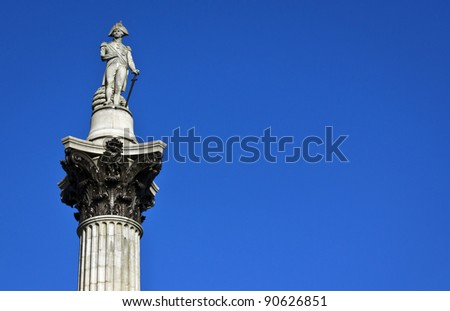 Nelson's Column rises to nearly 185 feet in the centre of Trafalgar Square and was erected to celebrate his great victory at Trafalgar over Napoleon in 1805 - stock photo