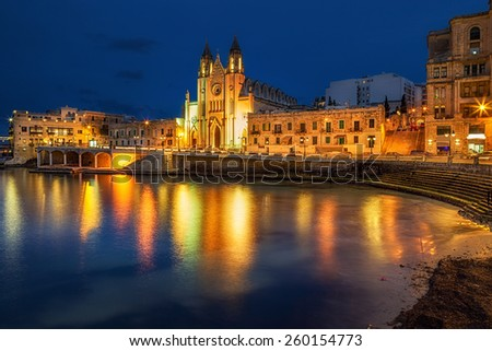 Neo-Gothic church of Our Lady of Mount Carmel (Balluta parish church) at night, situated in Balluta bay, Malta - stock photo