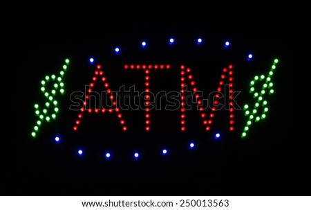 Neon ATM sign with Dollar Signs - stock photo
