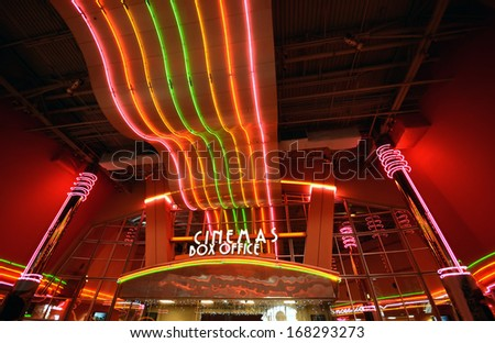 Neon lights at movie theater entrance and box office - stock photo