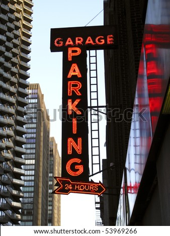 Neon Parking Garage Sign in an Urban Location - stock photo