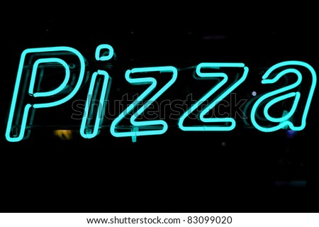 neon shining signboard with word pizza in blue at night - stock photo