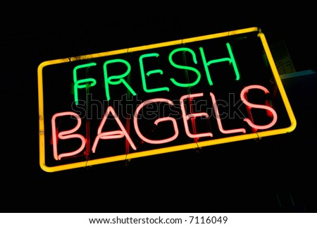 Neon sign at night - fresh bagels - stock photo