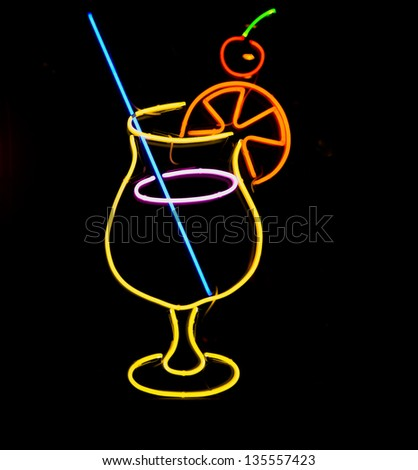 neon sign of a cocktail glass - stock photo
