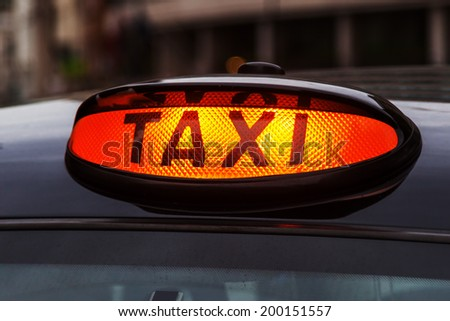 neon sign of a London Taxi - stock photo