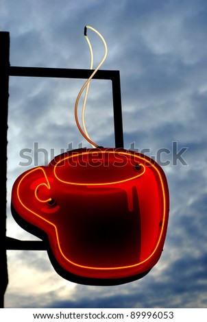 Neon sign of steaming cup of hot coffee - stock photo