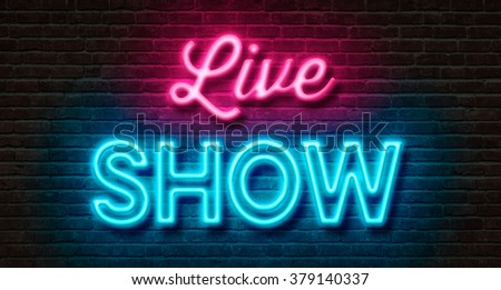 Neon sign on a brick wall - Live Show - stock photo