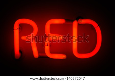 Neon Sign spelling Red - stock photo