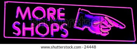 neon sign taken in time laps (bulb exposure) for maximum effect - stock photo