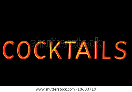 """Neon sign with the word """"Cocktails"""" over black - stock photo"""