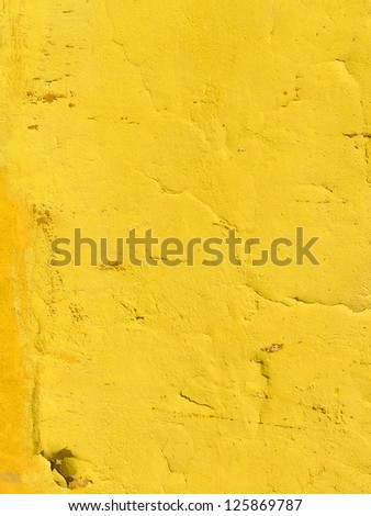 Neon vibrant yellow orange grungy wall texture. More of this motif and more backgrounds in my port. - stock photo