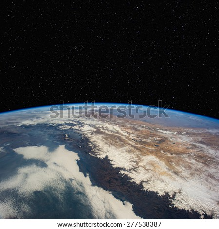 Nepal from space with stars above. Elements of this image furnished by NASA.  - stock photo
