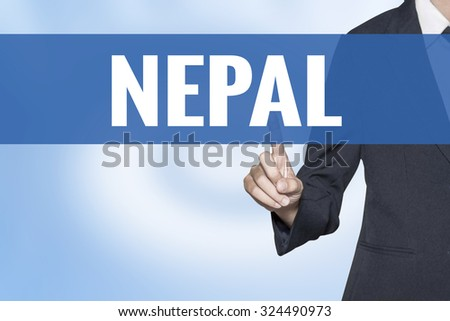 Nepal word on virtual screen touch by business woman blue background - stock photo
