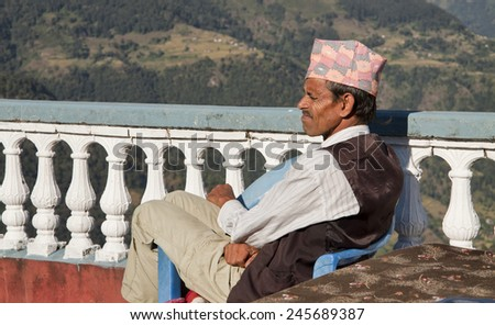 nepali men resting before hike - stock photo