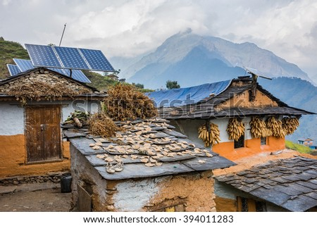 Nepali traditional houses with solar cell panel on the roof. Muri village, Dhaulagiri region. - stock photo