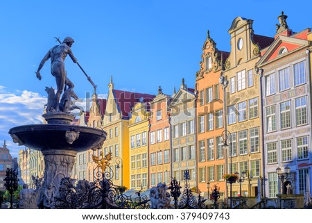 Neptune fountain statue in Gdansk with colorful gothic houses in the background, Poland - stock photo