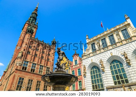 Neptune statue in Gdansk with famous cathedral in background , Poland - stock photo