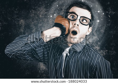 Nerd business man throwing a punch with clinch boxing hand at face to make a spectacle impact. Smashing Idea concept - stock photo