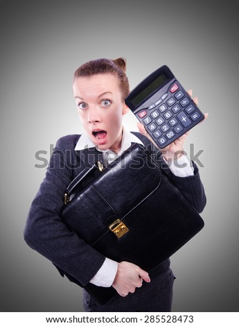 Nerd female accountant with calculator - stock photo