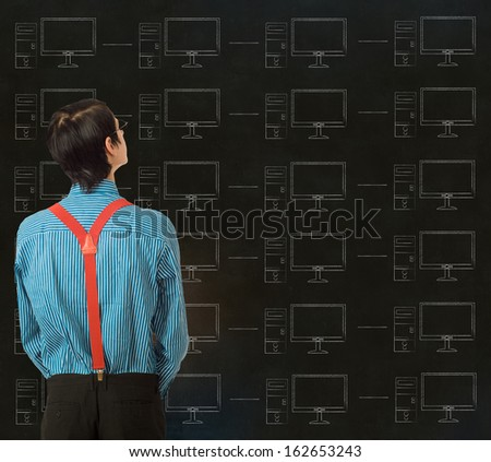Nerd geek businessman, student or teacher with chalk computer network on blackboard background - stock photo