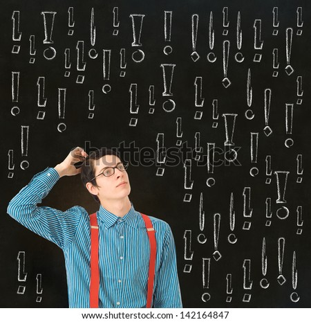 Nerd geek businessman, student or teacher with chalk exclamation marks on blackboard background - stock photo