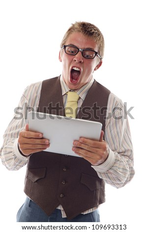 Nerd gets exciting news via his tablet - stock photo