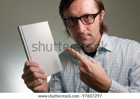 Nerd male holding book with empty covers, this image is a humorous concept photo. - stock photo