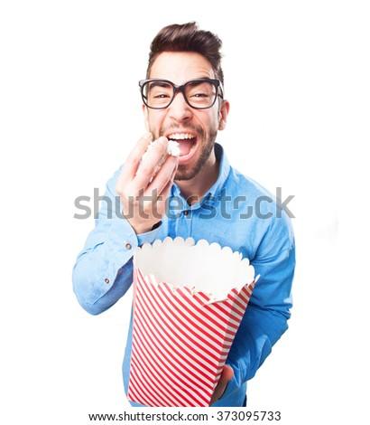 nerd man eating popcorn - stock photo