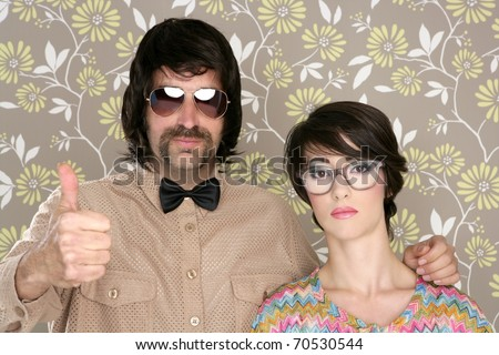 nerd silly couple tacky retro 60s man woman ok hand sign floral wallpaper - stock photo