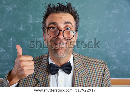 Nerd silly retro teacher man with braces funny expression ok thumb up gesture - stock photo