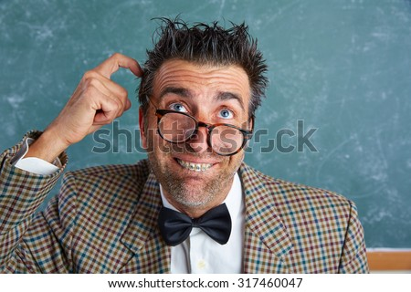 Nerd silly retro teacher man with braces funny thinking doubt expression - stock photo
