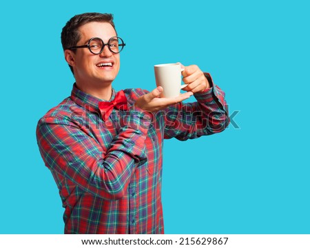 Nerd with cup of coffee on blue background. - stock photo